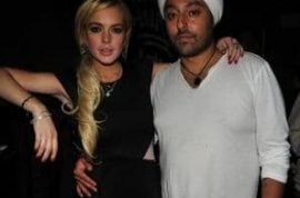 Lindsay Lohan causes a scene as she tells off her millionaire boyfriend's model wife.