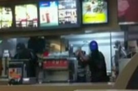McDonald's cashier launches into an all out assault on customer after they jump counter.