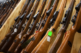 Americans buy record numbers of guns this Christmas.