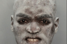 Who is this hawt bixch? Travis Williams would like to explain to you how he ended up getting arrested for disorderly conduct with a 'mystery' white powder all over his head.