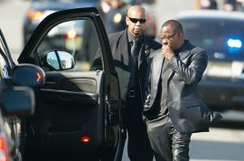 Bobby Brown storms out of Whitney's funeral after scuffle ensues.