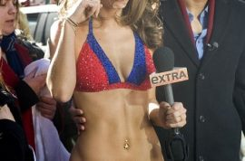 Maria Menounos media whores herself in a bikini after losing bet.