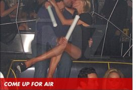 Camille Grammer wants to show you how to tongue pash in a crowded club.