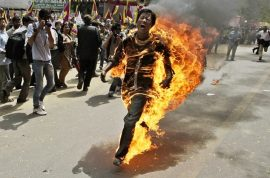 Video: Tibetan protester sets himself on fire ahead of Chinese president's arrival.