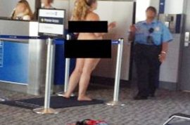 Video: Airport passenger strips completely naked when told she is not allowed to smoke.