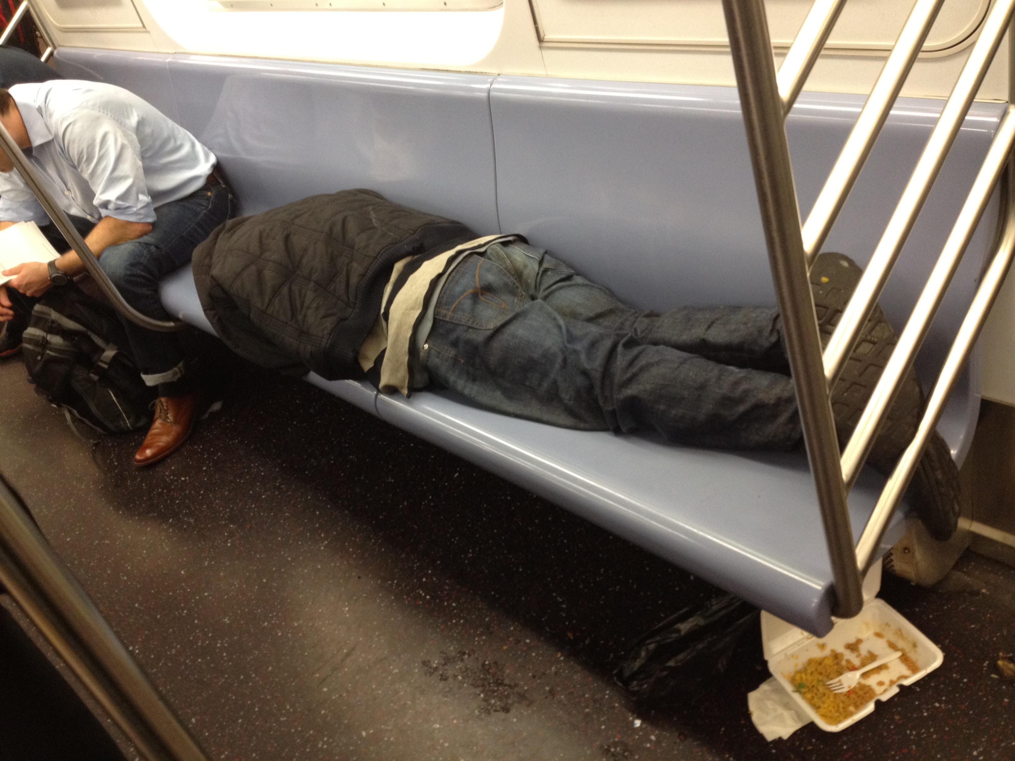 Homeless man on subway