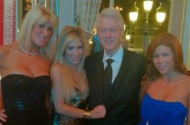 Yum-Bill Clinton poses with porn stars at Monte Carlo Casino.