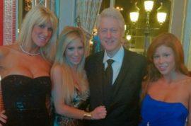 Yum-Bill Clinton poses with porn stars at Monte Carlo Casino.