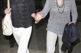 Jet lag? Ellen Degeneres and Portia De Rossi return to Los Angeles in love.