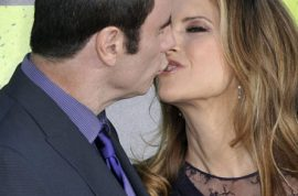 John Travolta attempts to give his wife a heterosexual kiss. Fails miserably