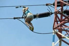 Video: Czech woman scales transmission tower while high as a kite.