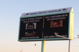 Idaho billboard compares Obama to Dark Knight shooter James Holmes.