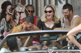 La Dolce Vita: Madonna turns up the radio cause she's a hawt bixch.
