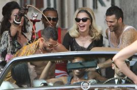 La Dolce Vita: Madonna turns up the radio cause she's a hawt bixch.