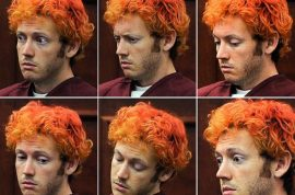 James Holmes spitting at guards. Forced to wear face mask. Is he literally going crazy?