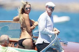 At 48 years of age Elle MacPherson is a wet dream in her itty bitty bikini while her boyfriend looks on…