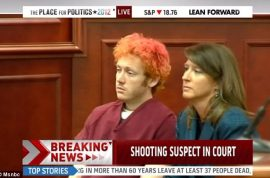 Frazzled James Holmes make his first court appearance. Could face death penalty, may plead insanity defense.