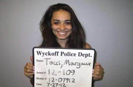 Smiling mugshot after teenager lured ex boyfriend into ambush for vicious beating.