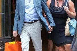 Oh my! James Bond's Pierce Brosnan takes his wife out shopping for designer shoes in Paris.