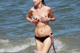 Juliette Lewis is still a preferred hawt bixch in her itty bitty bikini.