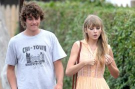 Taylor Swift consoles Conor Kennedy as they visit grave of his mother.