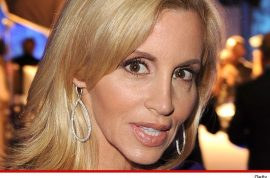 Camille Grammer's bikini pictures don't sit too well with ex husband Kelsey.