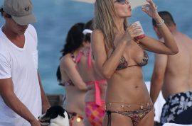 Oh my! Here's Rita Rusic again in a new bikini and belly chain.