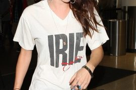 Kristen Stewart heads out to Toronto film festival wearing Robert Pattinson's IRIE t shirt.