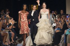 NY Publicist sues French editor for $1 million after she slaps her over Zac Posen seating issue.
