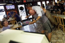 Oh my! President Barack Obama lifted in the air in bear hug by Florida Pizza owner.