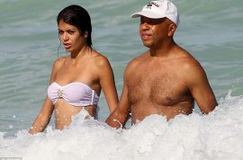 And here's Russell Simmons with his latest sugar daddy girlfriend…