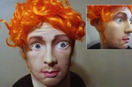 Too late. James Holmes Halloween mask removed from Ebay.