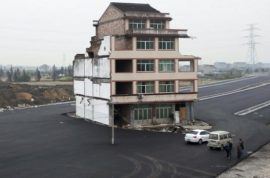 Chinese homeowner refuse to leave after motorway is built around his house.