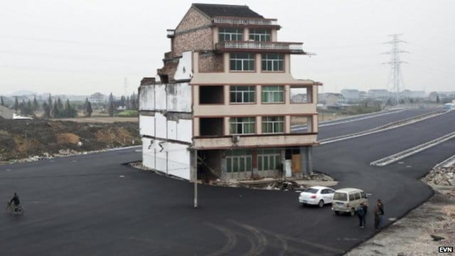 Luo Baogen refuses to give up his house in Xiayangzhang in the province of Zhejiang in eastern China.