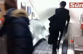 Drunk Japanese businessman amuses passengers on London tube.