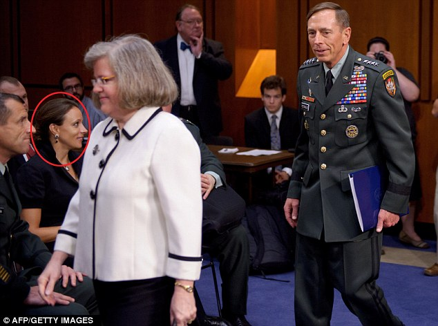 Paula Broadwell appears to be all love eyes for David Petraeus with Holly Petraeus in the foreground.