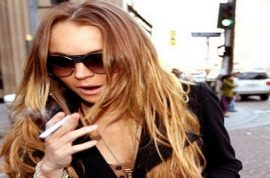 Lindsay Lohan has been drinking 2 litters of vodka a day and sniffing coke for months.