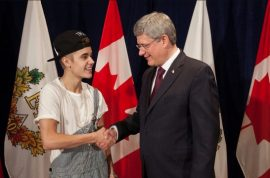 This is Justin Bieber wearing trash overalls to meet the Prime Minister of Canada, Stephen Harper.