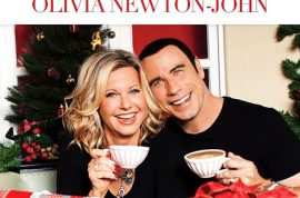 John Travolta and Olivia Newton John release the most dizzy Christmas video you could hope for.