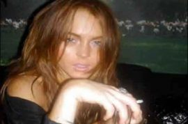 Oh really?! Lindsay Lohan will stay home for New Year's eve.