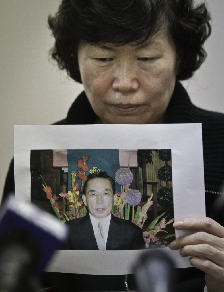 Serim Han holds a picture of her deceased husband Ki Suk Han