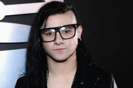 Oh really? Skrillex sets his hair on fire during birthday candle blow out.