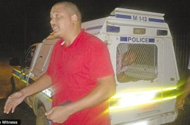 South African driver makes citizen arrest of drunk cop. Locks him up in his cruiser.