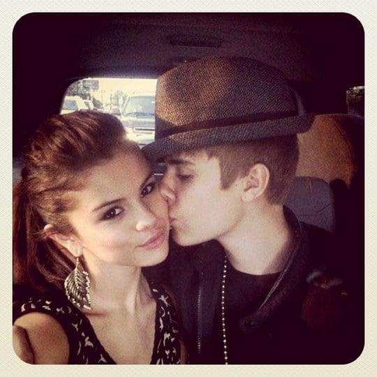 Justin Bieber kisses Selena Gomez.