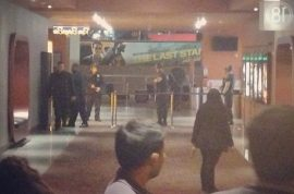 Gunmen who held LA mall hostage escape, still at large.
