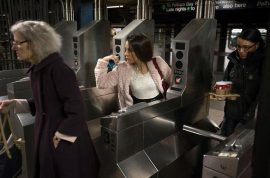 Man pooping between NYC subway cars slips and dies.