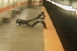 Here's a video of a woman getting punched, dragged and thrown onto subway tracks in Philadelphia.