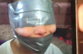 Ohio mom said to have wrapped kid's faces in duct tape and sent picture to father.