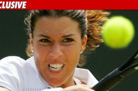 Jennifer Capriati charged with battery and stalking former boyfriend.