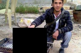 Syrian rebel holding pilot's decapitated head posted online.